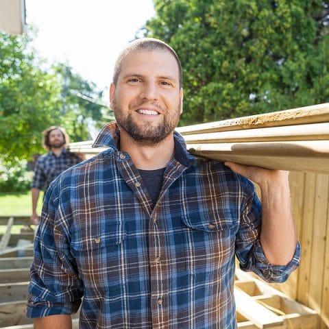 Men carrying lumber